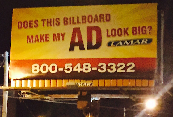 poorly advertised vacant billboard