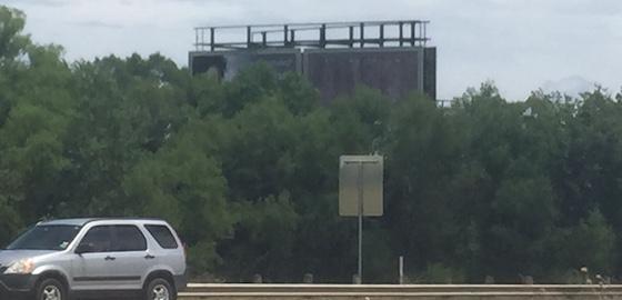 trees blocking billboard